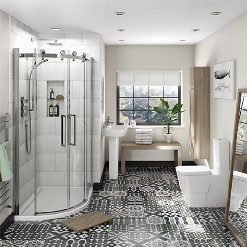 white toilet and basin with curved shower enclosure